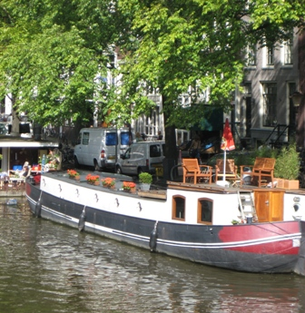 Amsterdam's visitors share the canal with a special breed of homeowners.