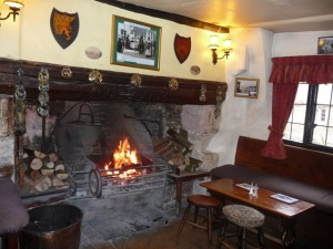 Warm up by the fireside of a centuries-old pub