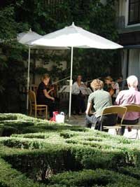 Behind the gabled facades of the canal houses are small private gardens - just perfect for a string quartet.