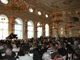 Concert-goers at Prague's Spanish Hall anticipate an evening of piano
