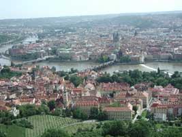 A view of the Vltava River winding under the Charles Bridge, Prague's romantic walking bridge.