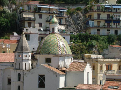 Clustered around a ceramic-domed church, the picturesque village of Cetara hugs a rocky seaside cliff.