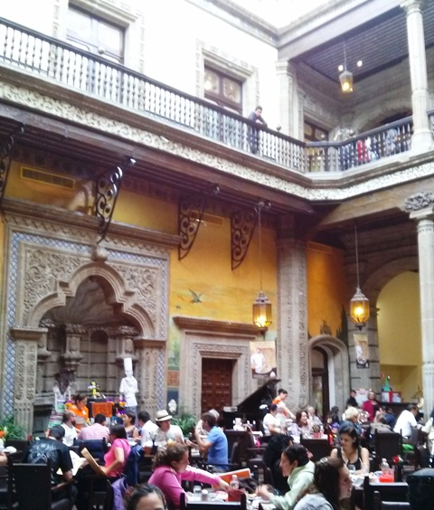 10241503 interior courtyard bustling with diners